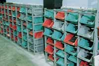 Plexton hopper containers in racks in warehouse